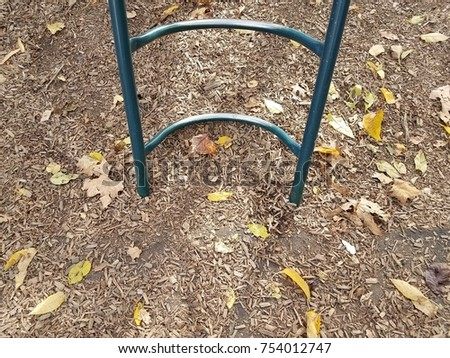 metal ladder in bark chips at playground #754012747