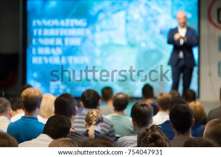 Audience listens to the lecturer at the conference hall Royalty-Free Stock Photo #754047931