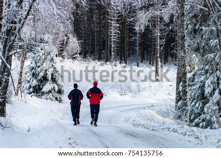 Couple running on a forest road #754135756