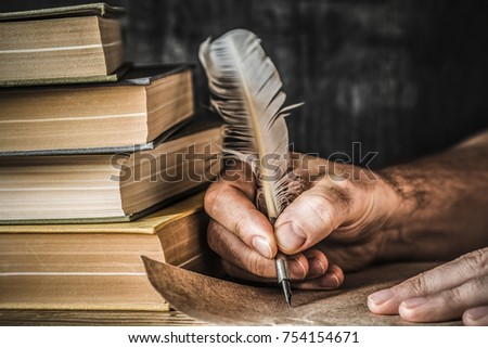 Man writing an old letter. Old quill pen, books and papyrus scroll on the table. Historical atmosphere. #754154671