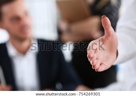 Businesswoman offer hand to shake as hello in office closeup. Serious solution friendly support service excellent prospect introduction or thanks gesture gratitude invite to participate concept #754269301
