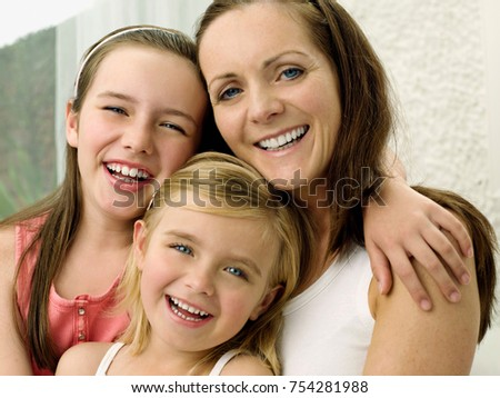 A portrait of a mother and two daughters #754281988