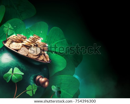 Saint Patricks day background with gold pot and four leaf clovers on a dark background / high contrast image