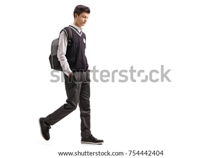 Full length profile shot of a pensive teen student walking isolated on white background #754442404
