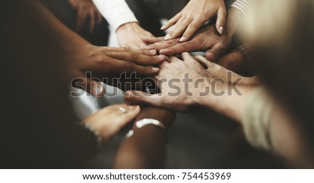 People with joined hands as a team #754453969