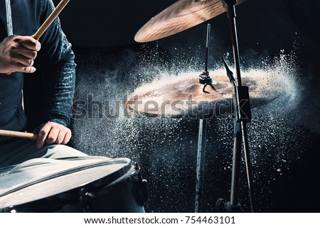 Drummer rehearsing on drums before rock concert. Man recording music on drum set in studio #754463101