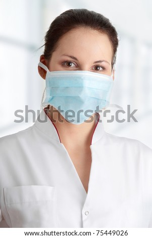 Young nurse in mask , isolated on white background #75449026