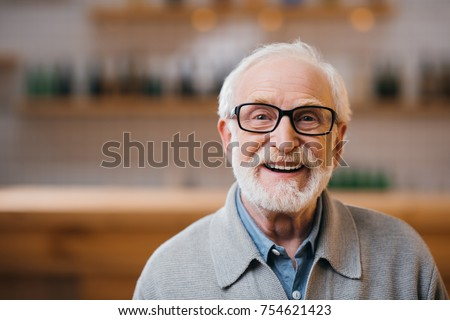 close-up portrait of happy senior man looking at camera #754621423