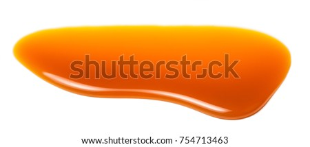 Sweet caramel sauce drop  isolated on white background close up. Golden Butterscotch toffee caramel liquid.  #754713463