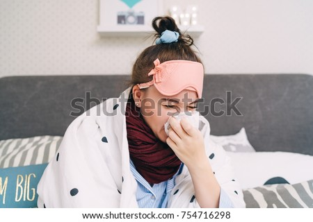 Young sick woman with cold and flu sneezing.  Seasonal influenza and virus. Healthcare concept Royalty-Free Stock Photo #754716298