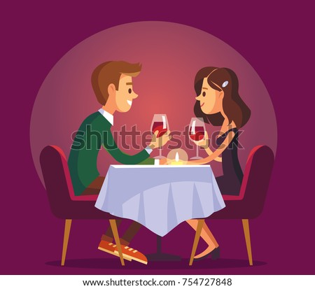 Dating. Valentines day celebration. Sweet happy young couple having romantic dinner with glasses of red wine on date.Drink wine.Christmas evening celebration.Pair couple together at  the dinner table. Royalty-Free Stock Photo #754727848