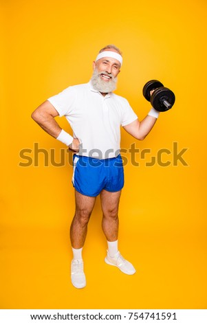 Full length of cool crazy insane emotional active grandpa with win happiness grimace, exercising, training, holding equipment, lifts it up, wears sexy shorts, sneakers, so hot! #754741591