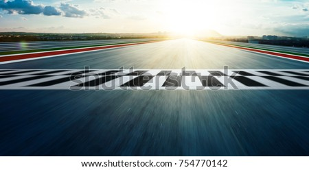 Motion blurred racetrack with start or end line . Royalty-Free Stock Photo #754770142