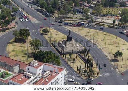 Mexico City, March 16, 2015: aerial view of Cuitlahuac monument in the downtown part of this huge city #754838842
