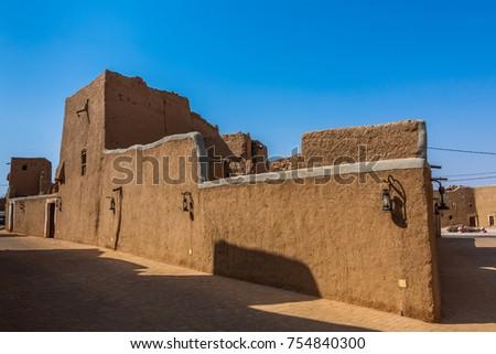 Traditional Arab mud brick architecture in Al Majmaah, Saudi Arabia #754840300