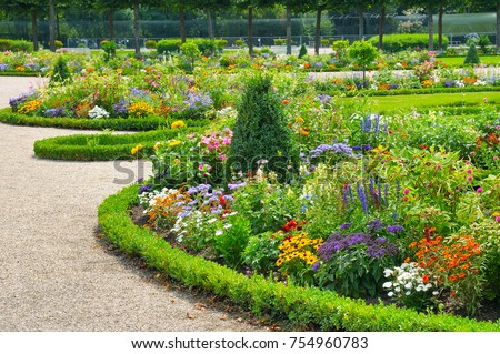 Bright flower bed in a summer park. #754960783