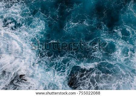 Aerial view to ocean waves. Blue water background #755022088