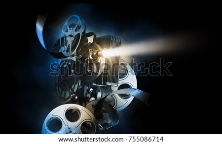 Cinema background with movie projector and film reels on a dark background / high contrast image #755086714