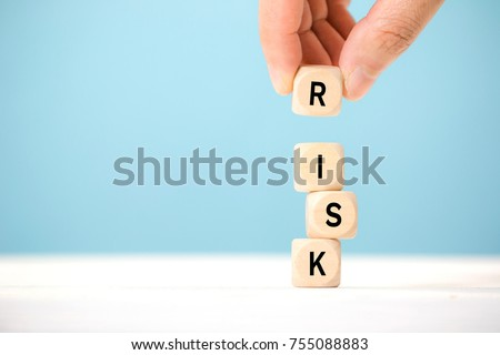 Hand hold wooden cubes with risk word. Risk management concept. Royalty-Free Stock Photo #755088883