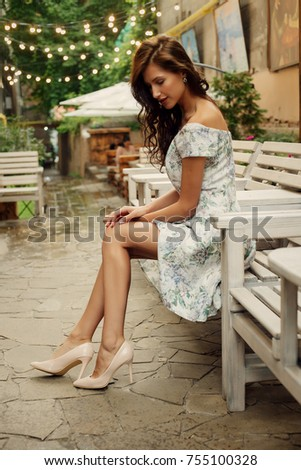 travel, coffee, leisure, lifestyle and people concept -Beautiful lady in a restaurant. Portrait of a beautiful young woman being cheerful at night in a Restaurant. #755100328