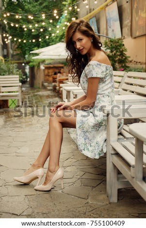 travel, coffee, leisure, lifestyle and people concept -Beautiful lady in a restaurant. Portrait of a beautiful young woman being cheerful at night in a Restaurant. #755100409