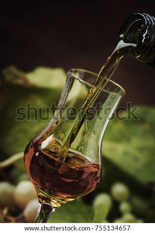 Golden Alcoholic Drink Being Poured Into Shot Glass, Rustic Still Life, Selective Focus #755134657