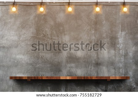 Empty brown wood plank board shelf at grunge concrete wall with light bulb string party background,Mock up for display or montage of product or design. Royalty-Free Stock Photo #755182729