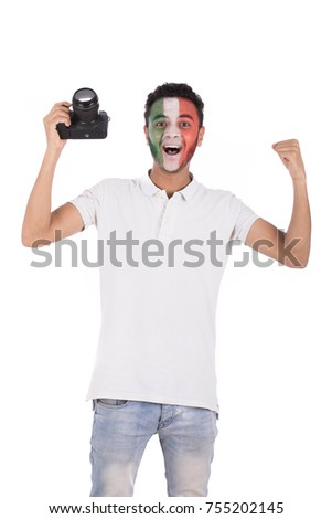 excited soccer fan taking snaps of his favorite game. Isolated on white background.