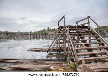 wood bridge on the songalia river  #755272792