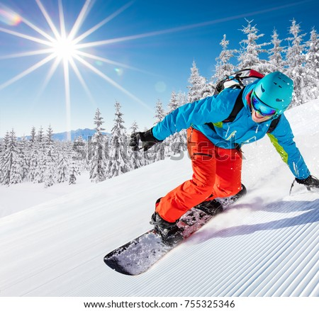 Skier skiing downhill during sunny day in high mountains #755325346
