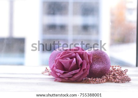 Christmas decoration, artificial flower and balls against window #755388001