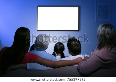 Family and blank TV display at home #755397592
