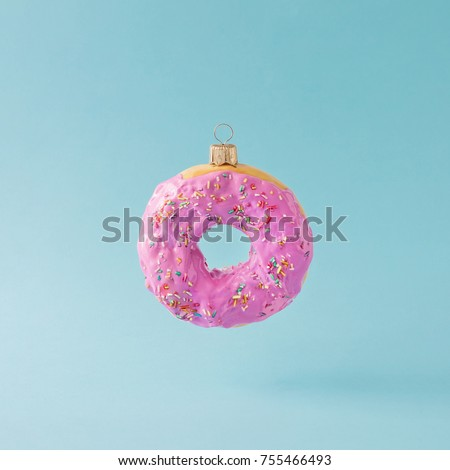 Christmas bauble decoration made of pink doughnut. Minimal New year concept. #755466493