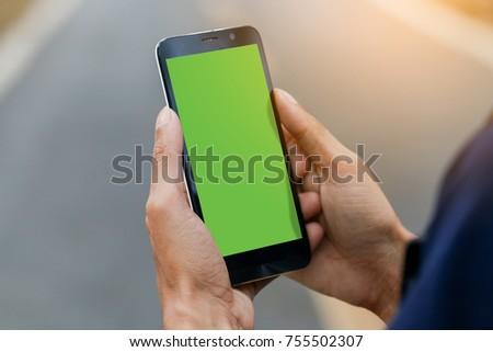 Man use smart phone. Green screen.