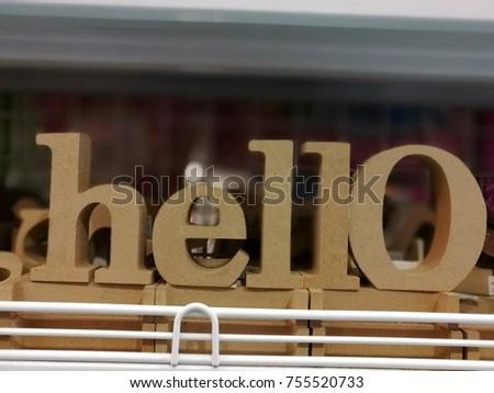 Hello word, sign od wooden charector decor on shelf #755520733