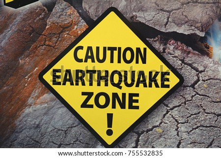 Caution Earthquake Zone Sign on Cracked Rock Background #755532835