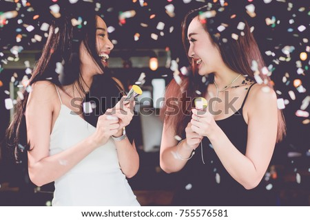 celebration party group of Two asian young  women people holding confetti happy and funny concept. In 2018 New year holiday. #755576581
