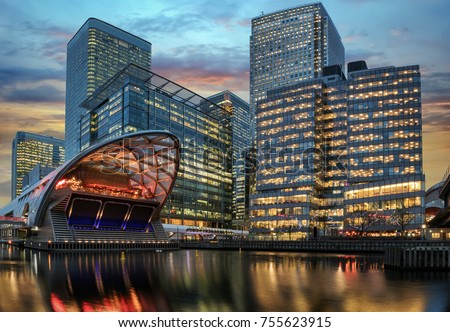 The financial district Canary Wharf in London during sunset #755623915