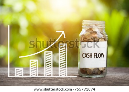 Cash Flow Word With Coin In Glass Jar and graph up. Financial Concept Royalty-Free Stock Photo #755791894