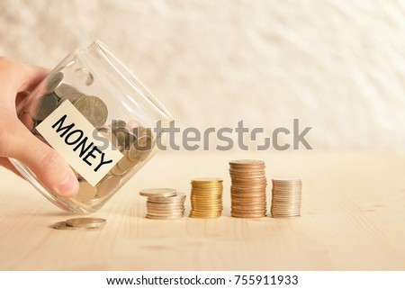 Coins in glass jar for money saving financial concept #755911933