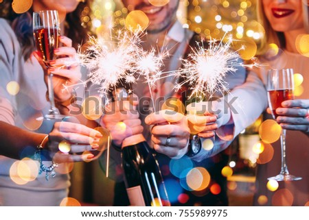 Friends celebrating Christmas or New Year eve with Bengal lights. #755989975