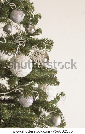 white and silver Christmas balls on the Christmas tree in the new year #756002155