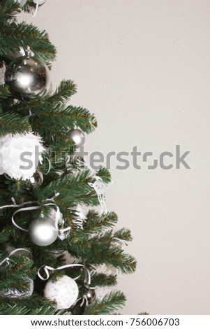 white and silver Christmas balls on the Christmas tree in the new year #756006703