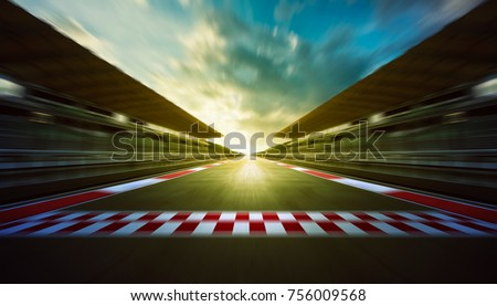 Evening speedy motion blur international race track with starting and finishing line . #756009568