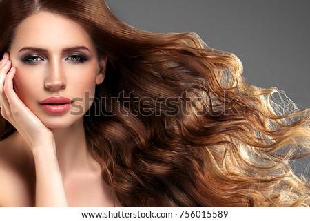 Beautiful hair woman beauty skin portrait over dark background. Long beautiful healthy hair model girl stock image. Studio shot. #756015589