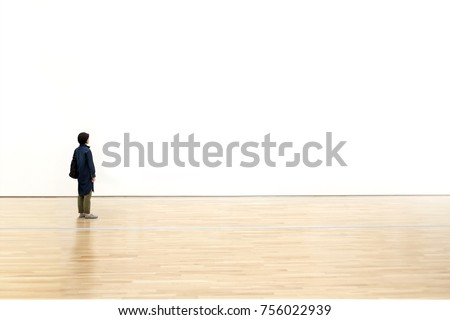 Woman watching  blank space wall in modern gallery, Art exhibition minimal concept Royalty-Free Stock Photo #756022939