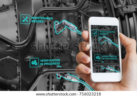 Augmented Reality technology maintenance and service of mechanical parts, technician using smartphone with AR interface on screen in smart industry, automated monitoring process #756023218