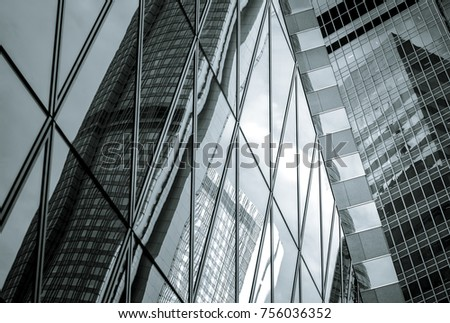 windows of commercial building in Hong Kong with B&W color #756036352