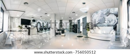 Panoramic view of a modern bright beauty salon. Hair salon interior business Royalty-Free Stock Photo #756050512
