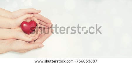 Parent and child holding heart in hand. Health care, family insurance concept #756053887